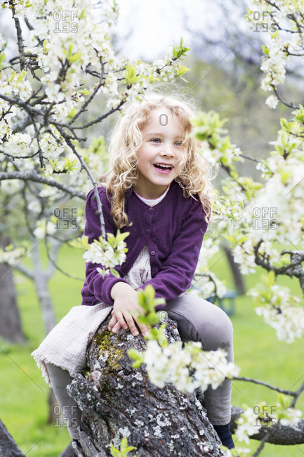 Smiling girl near blooming tree