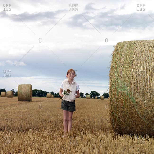 Smiling girl on field - Offset