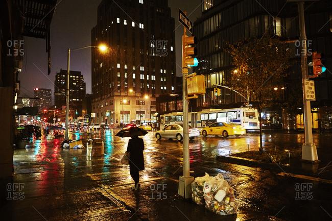 New York City, New York - October 23, 2014: Traffic in downtown on rainy night
