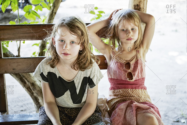 Two girls looking impatient - Offset