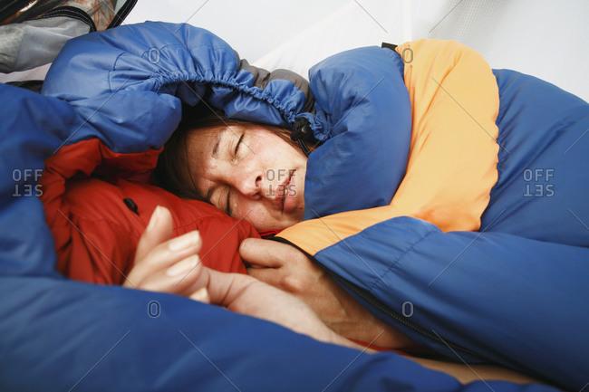 Woman sleeping in sleeping bag