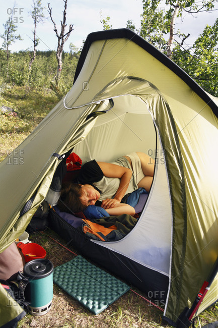 Woman sleeping in tent