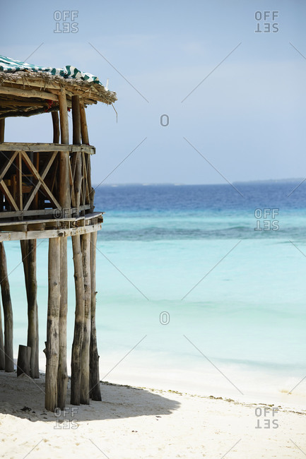 Wooden building on tropical beach