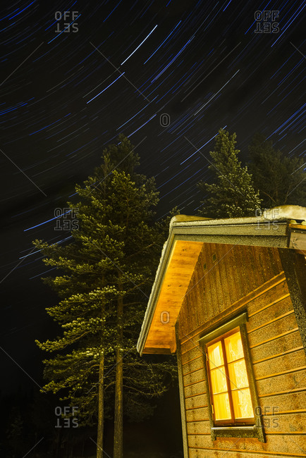 Wooden building against starry sky
