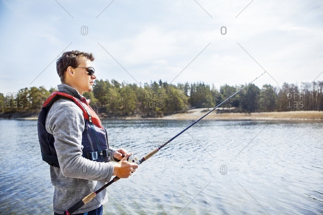 Profile of a young man fishing