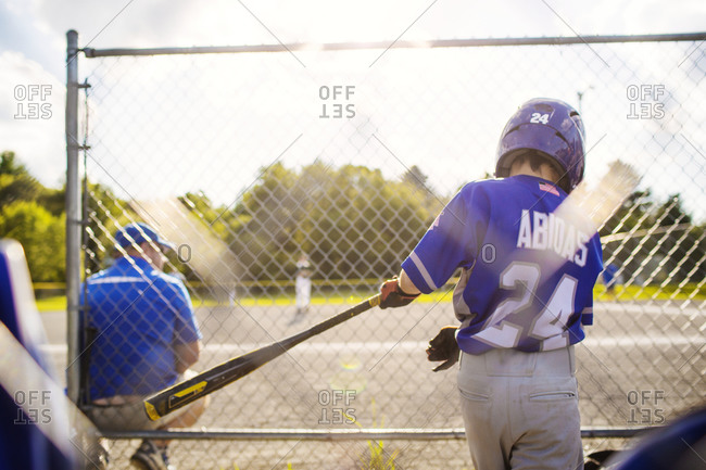 A youth leaguer in a batting cage