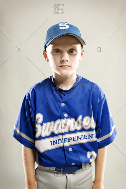 A portrait of a young boy in a little league uniform