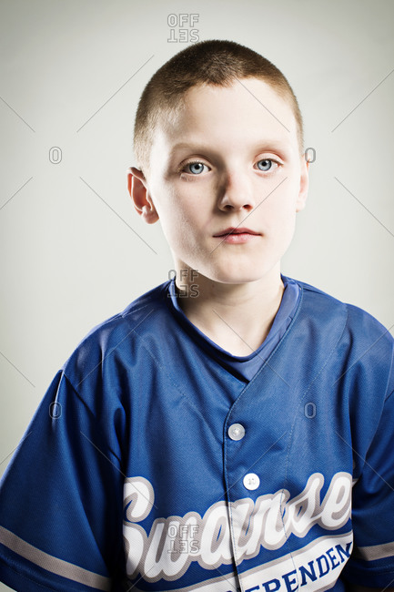 A portrait of a boy in a youth league uniform