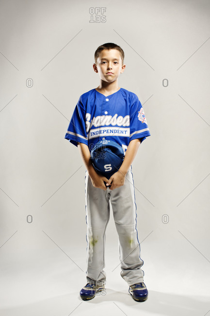 A youth leaguer with his cap in hand