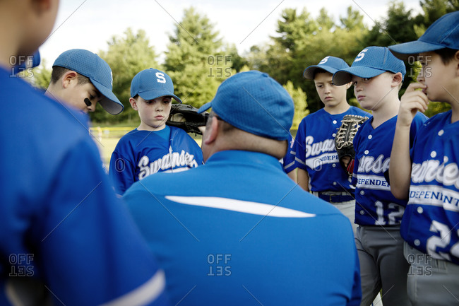 A youth league coach gives his team a pep talk