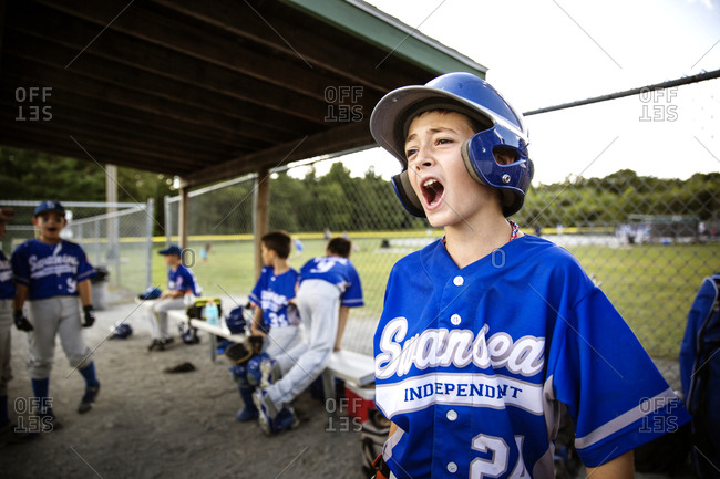 A youth league player yells from the dugout