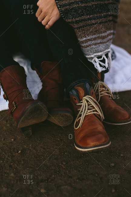 Close up of couple wearing leather boots
