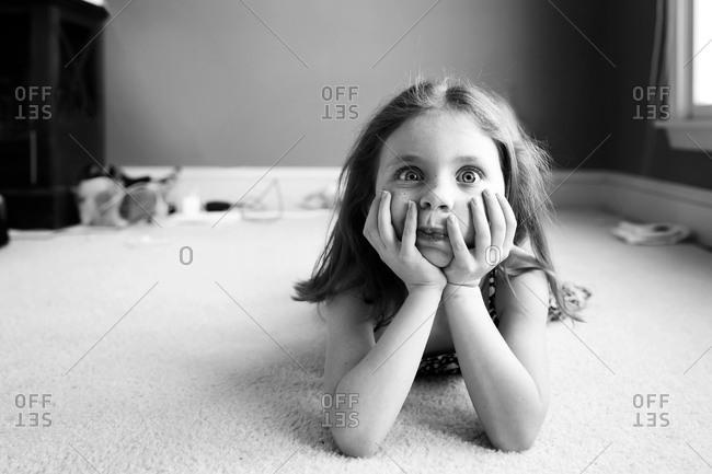 A little girl makes a goofy face