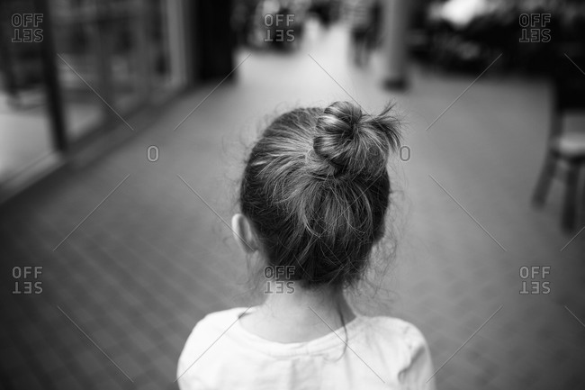 Rear view of a little girl with her hair in a bun