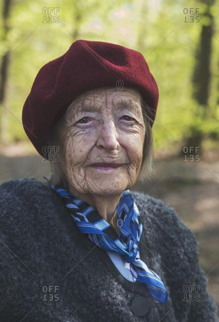 Portrait of senior woman smiling at the park