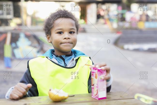 Portrait of boy with juice box