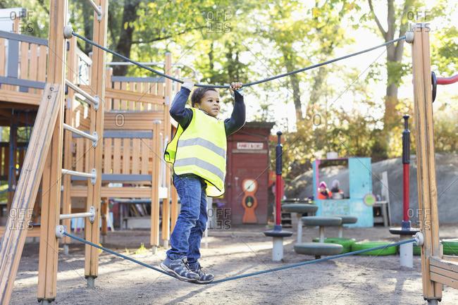 Boy balancing on rope at playground