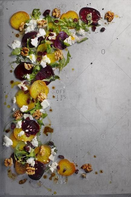 A stripe of beet salad with goat cheese and buttery walnuts