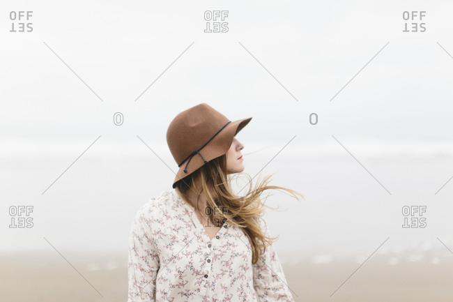 Profile of young Caucasian woman on beach