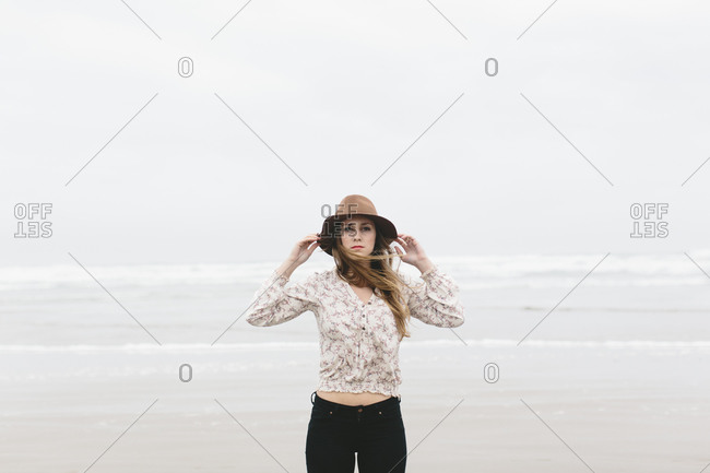Portrait of young hip Caucasian woman on beach