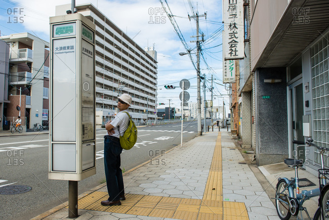 Yokohama, Japan - August 15, 2014: A man waits for a bus outside of Tateba Station