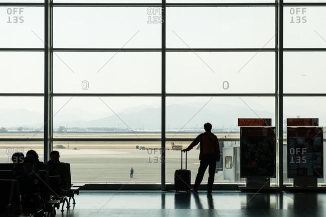 Busan, South Korea - March 17, 2015: Man waiting at the Gimhae International Airport