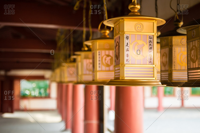 Lanterns hanging in the arcade of a building at the Shitennoji Temple in Osaka, Japan