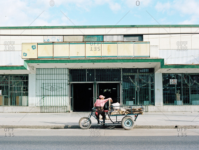 Havana, Cuba - March 5, 2015: Man sitting on a bicycle in a street