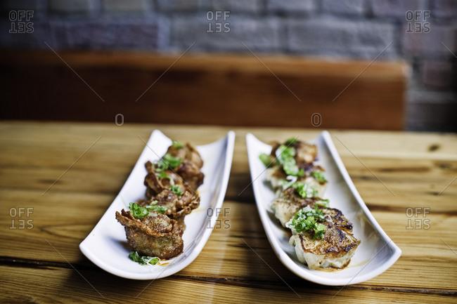 Spicy dumplings on platters