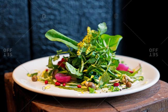 Fresh salad with shimeji mushrooms