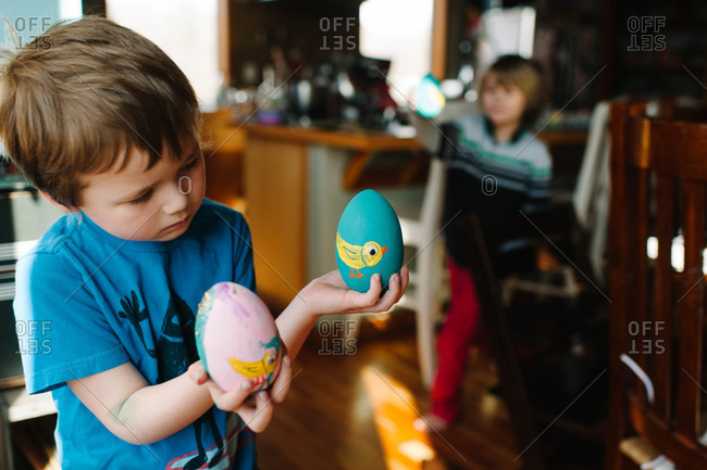 Young boy holding Easter eggs in his hands