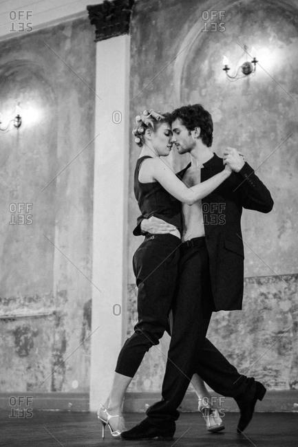 A couple dances close together