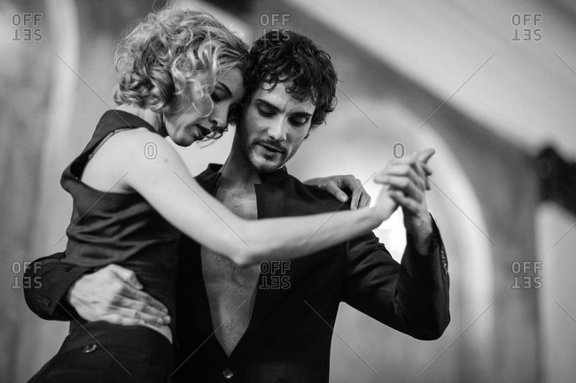 Two dancers engaged in the tango