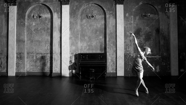 A dancer poses in a ballroom