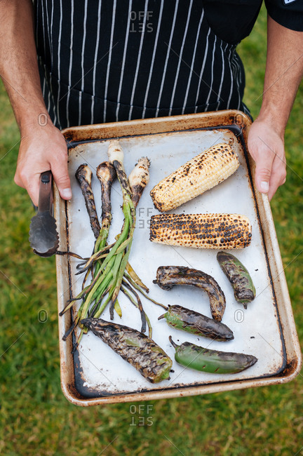 Grilled corn, ramps, and peppers on tray
