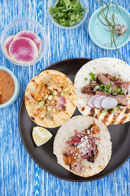 Tacos and toppings at outdoor picnic