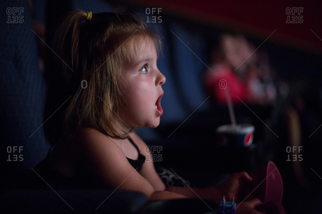 Girl in movie theater surprised