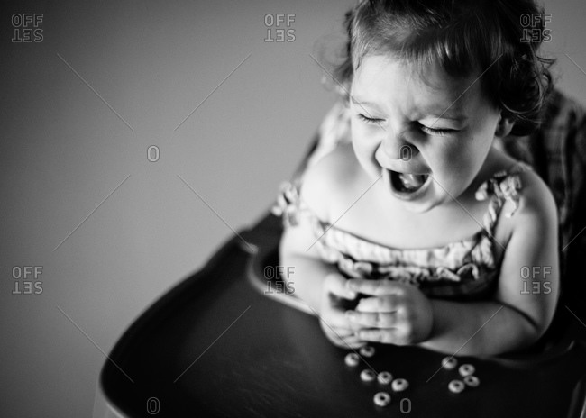 Girl in high chair screaming