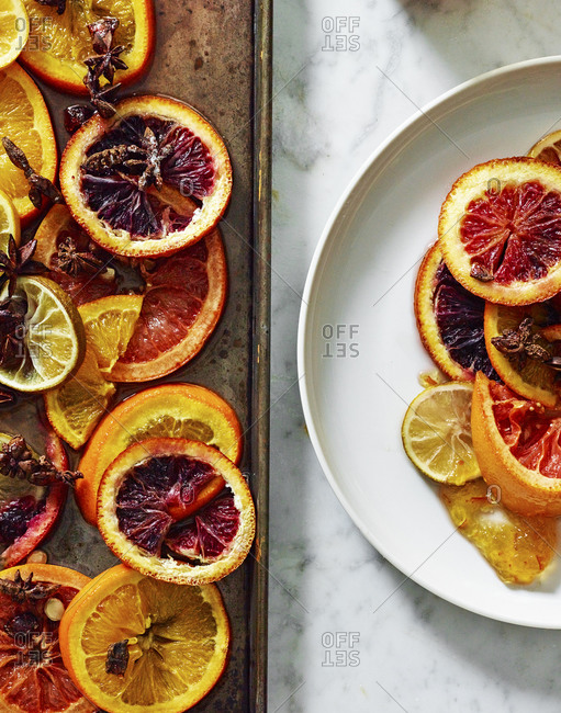 Citrus fruit on a baking pan and a plate
