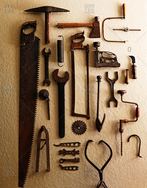 Antique tools on a pegboard