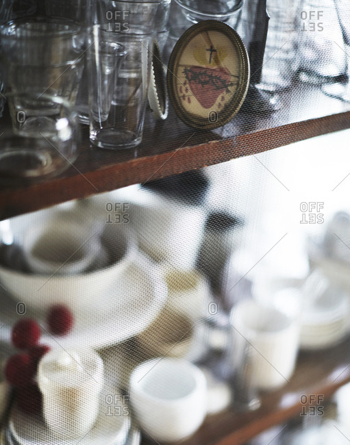 Glassware and trinkets behind a screen