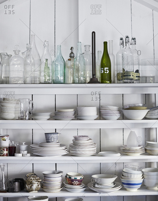 Wooden shelves filled with dishware