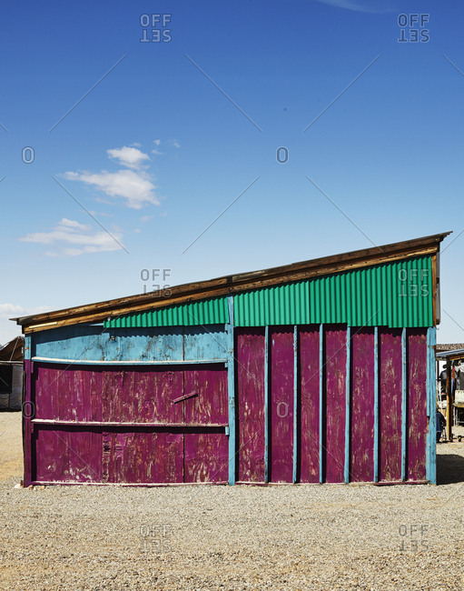A brightly painted lean to