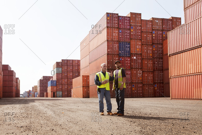 Freight yard employees inspecting cargo