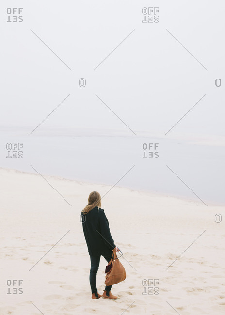 Woman standing at the Dune of Pilat, France