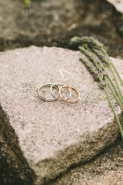 Wedding rings on a rock