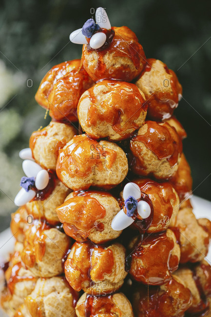close up of a croque en bouche with caramel stock photo. Black Bedroom Furniture Sets. Home Design Ideas