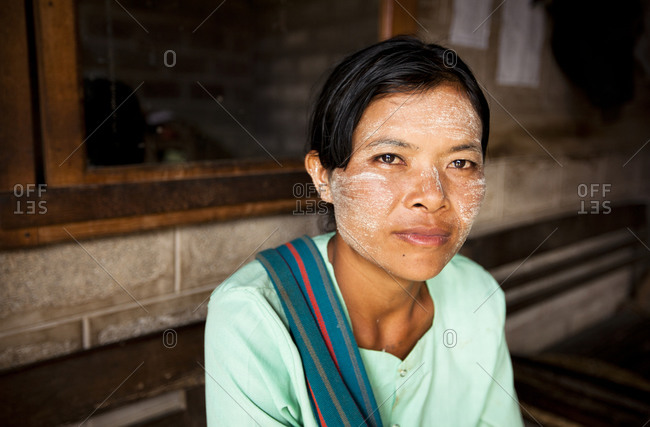 Nyaung Shwe, Myanmar - August 19, 2011: Burmese woman with thanaka on her face