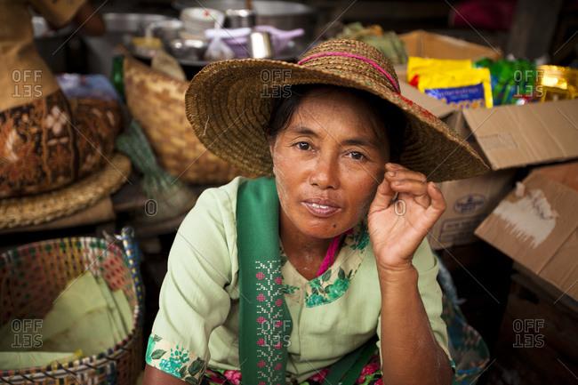 Nyaung Shwe, Myanmar - August 19, 2011: Seller in Nyaung Shwe market, Myanmar