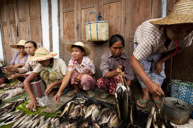 Nyaung Shwe, Myanmar - August 19, 2011: Fishmongers in Nyaung Shwe Market, Myanmar